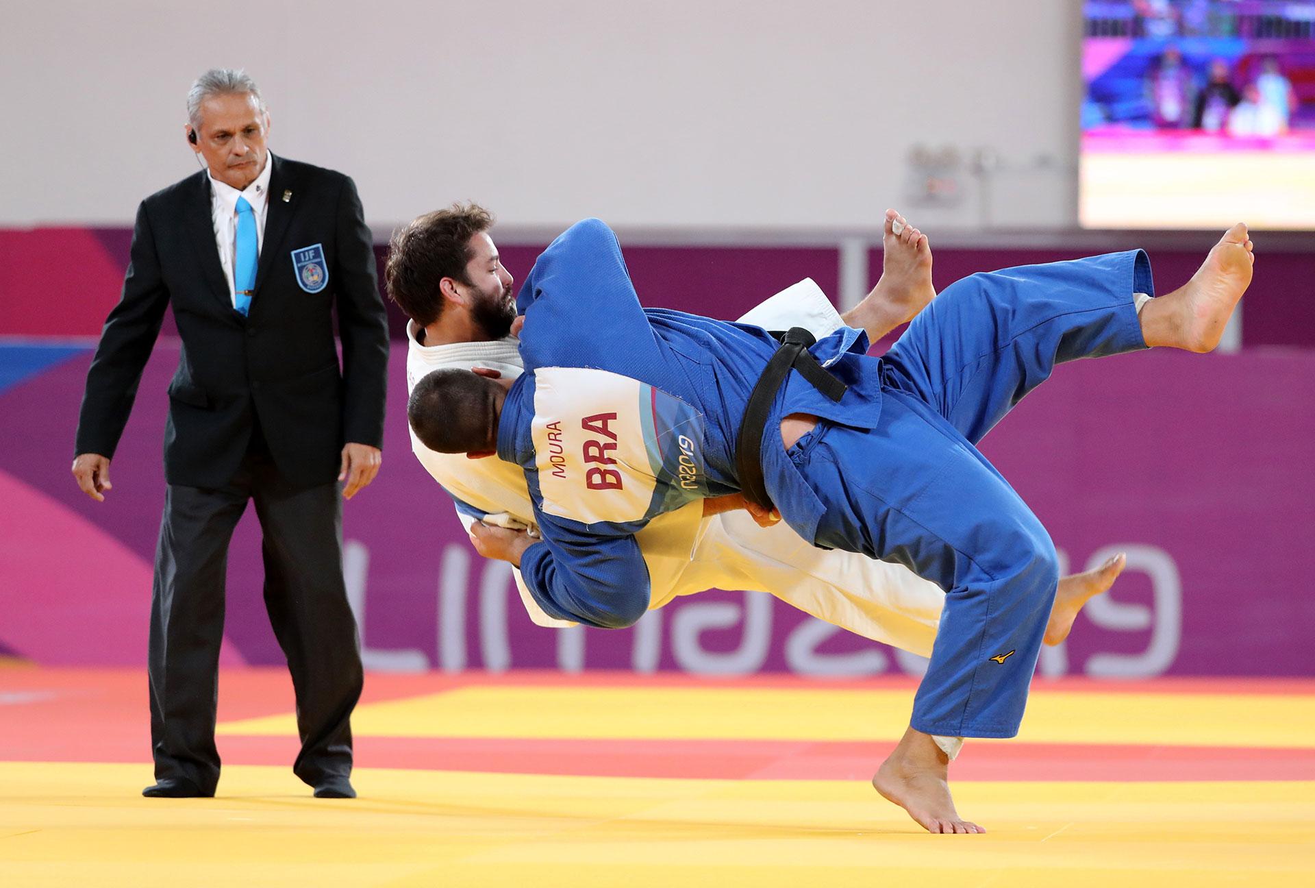 XVIII Pan American Games - Lima 2019 - Judo - Men's +100 kg Bronze Medal Match - Villa Deportiva Nacional, Videna, Lima, Peru - August 11, 2019 Ajax Tadehara of the U.S. and Brazil's David Moura in action. REUTERS/Sergio Moraes