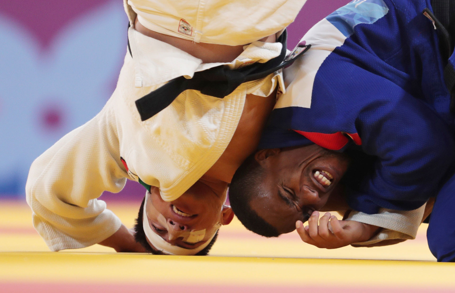 Judo XVIII Pan American Games - Lima 2019 - Men's 66kg Bronze - Villa Deportiva Nacional, Videna, Lima, Peru - August 9, 2019. Cuba's Osniel Solis and Mexico's Nabor Castillo in action. REUTERS/Guadalupe Pardo     TPX IMAGES OF THE DAY
