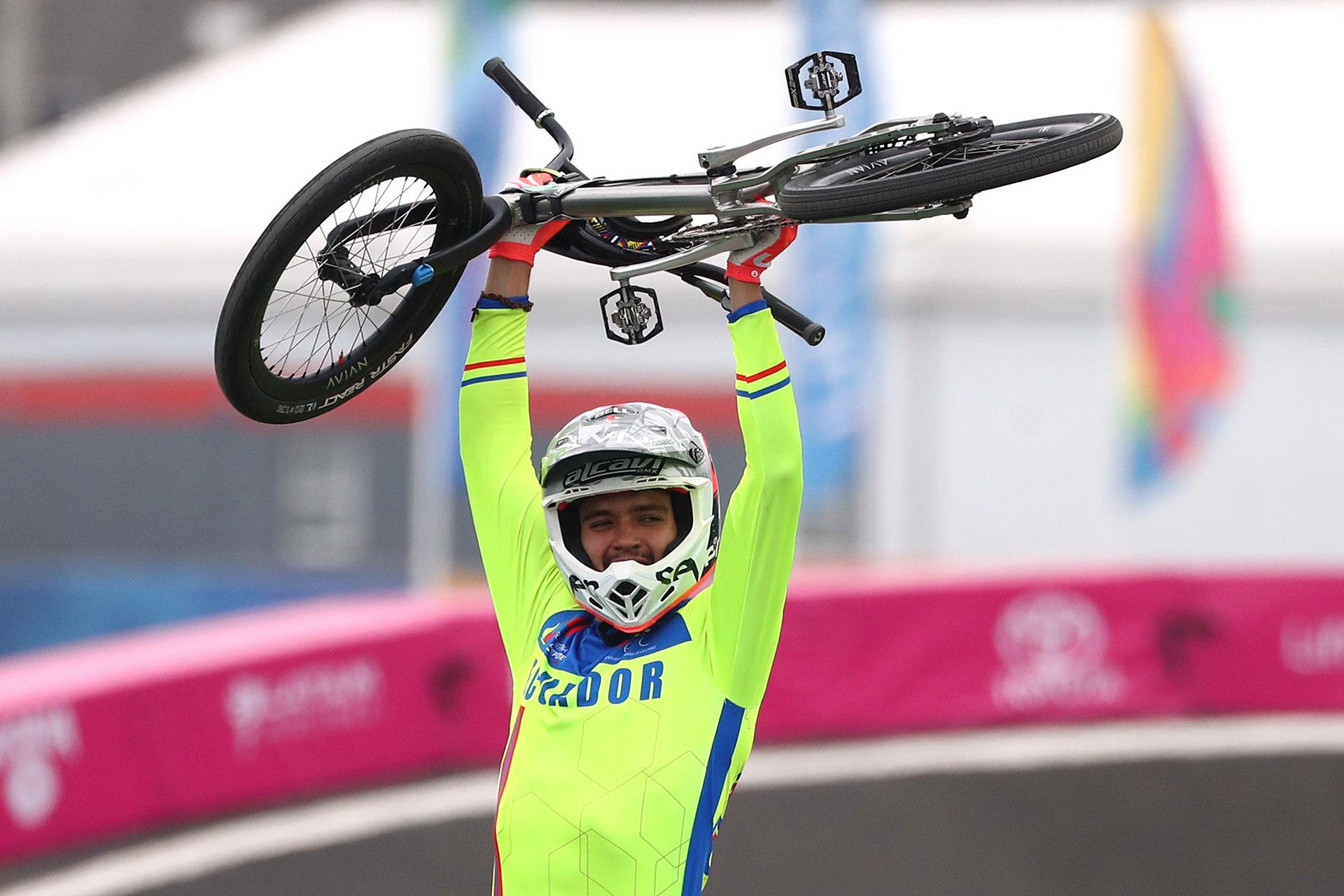 XVIII Pan American Games - Lima 2019 - Cycling BMX - Women Semifinal  - Costa Verde Beach Circuit, Lima, Peru - August 9, 2019. Gold medalist Ecuador's Alfredo Campo celebrates after the race. REUTERS/Pilar Olivares