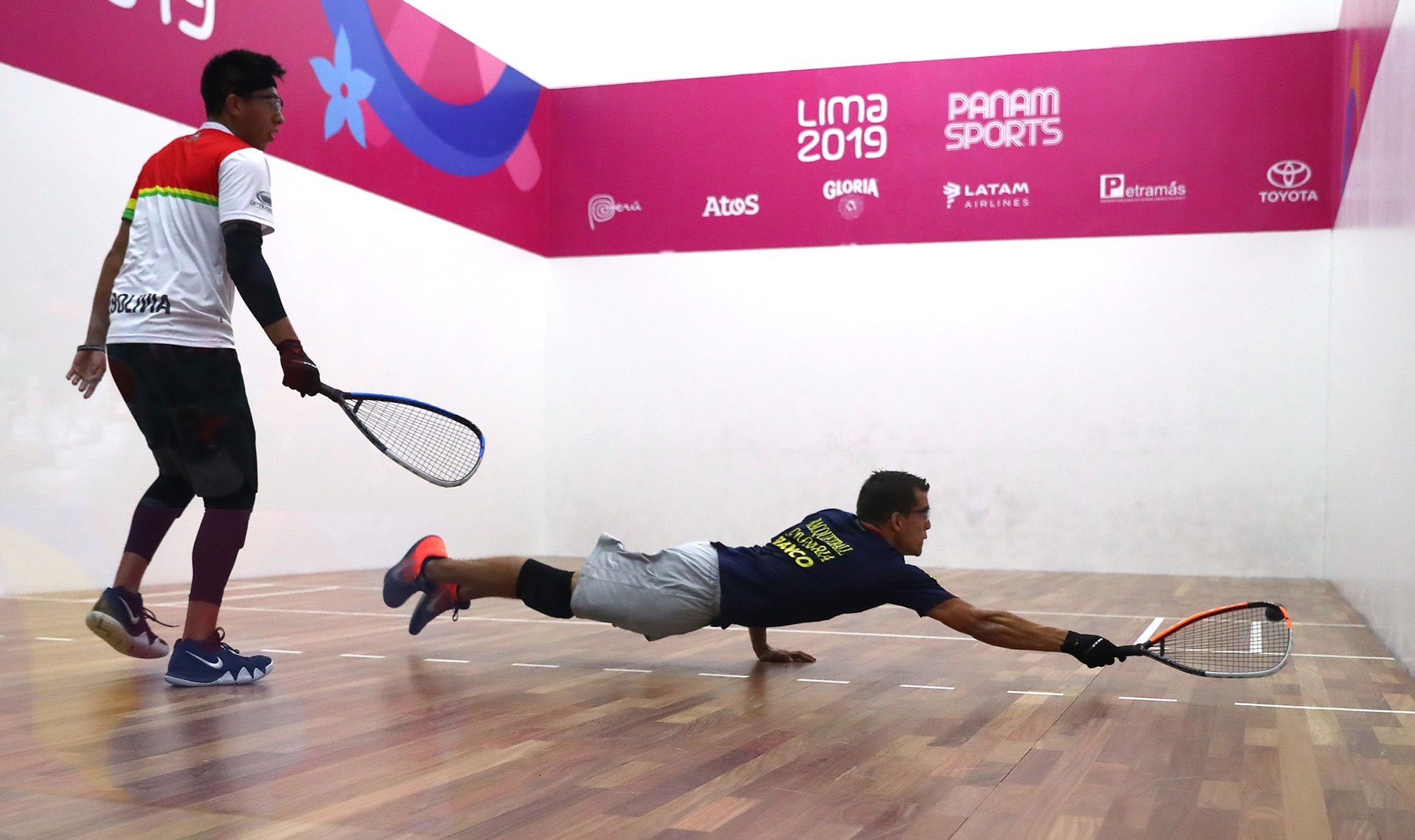 XVIII Pan American Games - Lima 2019 - Racquetball - Men's Team Gold Medal - Racquetball Courts, Lima, Peru - August 10, 2019. Colombia's Sebastian Franco and Bolivia's Carlos Keller in action. REUTERS/Pilar Olivares