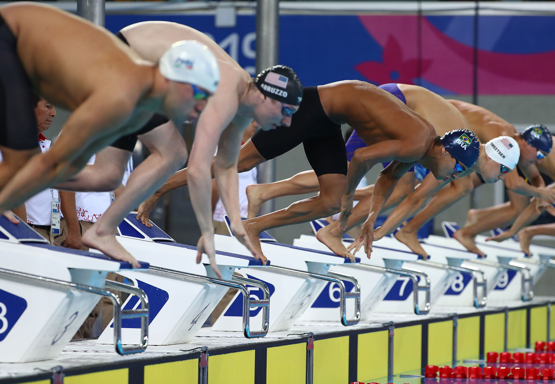 Swimming  XVIII Pan American Games - Lima 2019 - Men's 200m Individual Medley - Aquatic Center, Lima, Peru - August 10, 2019. William Licon of the U.S., between José Angel Martinez Gomez, and Brazil's Caio Rodrigues Pumputis at the start of the race. REUTERS/Pilar Olivares